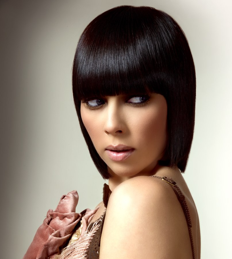 Sleek Glassy Bob And A Fringe Cut With Rounded Corners
