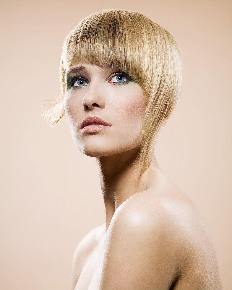 Razor Cut Hair With Asymmetrical Side Strands