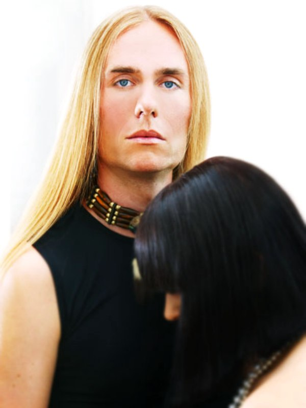 Man With Long Flaxen Locks And A Girl With An Ultra Smooth