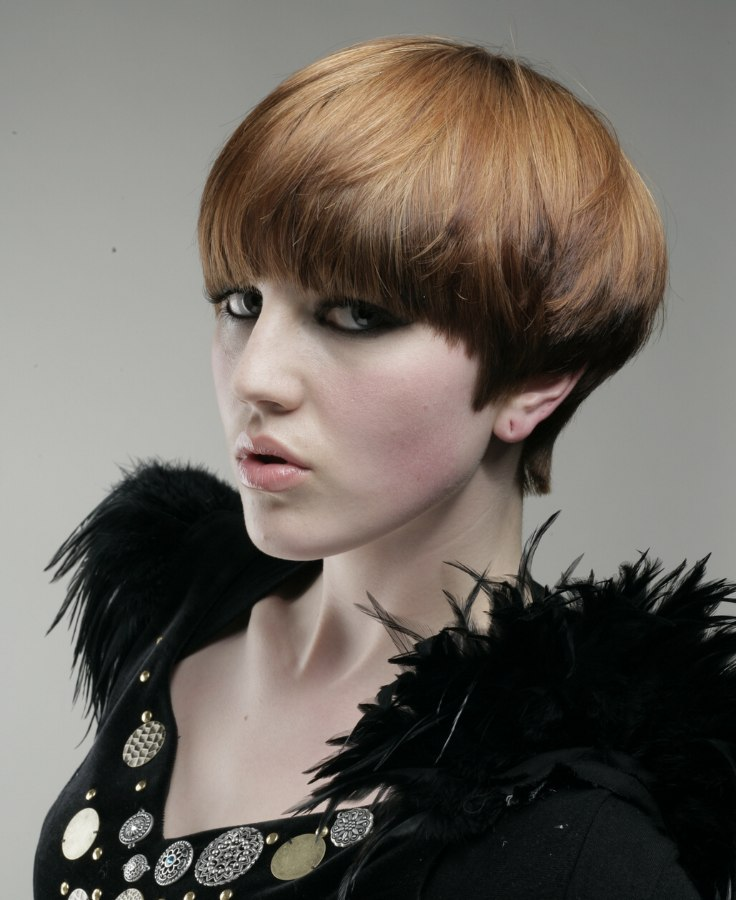 Short Hairstyle With A Round Silhouette And A Copper Hair