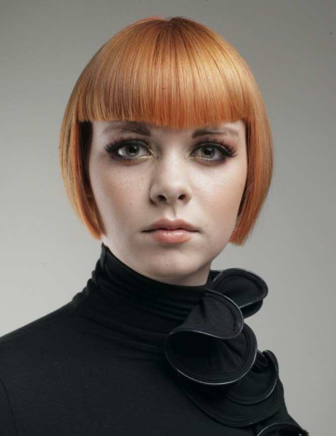 short reddish blonde under the ears bob haircut with bangs