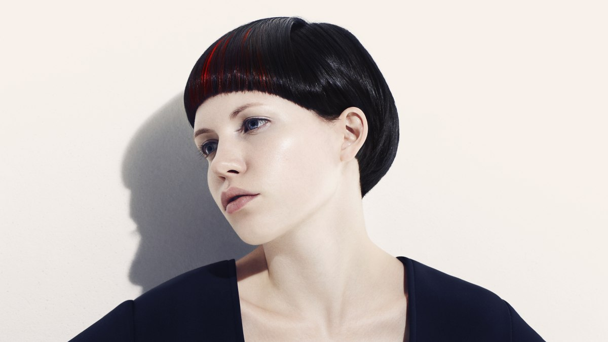 Short Round Bowl Style Haircut Black Hair With Red Strands