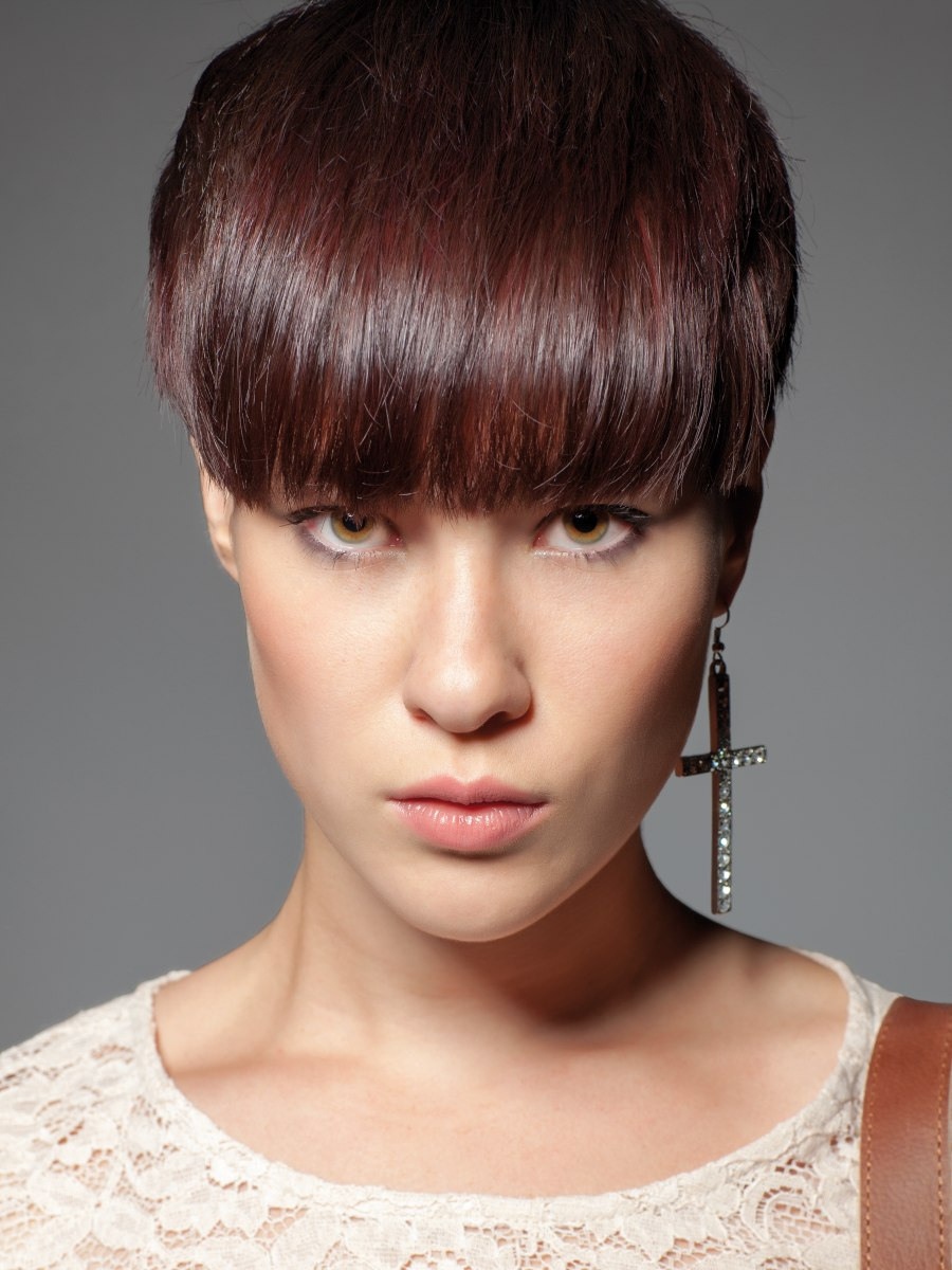 Short Hairstyle With A Thick Fringe That Covers The Eyebrows