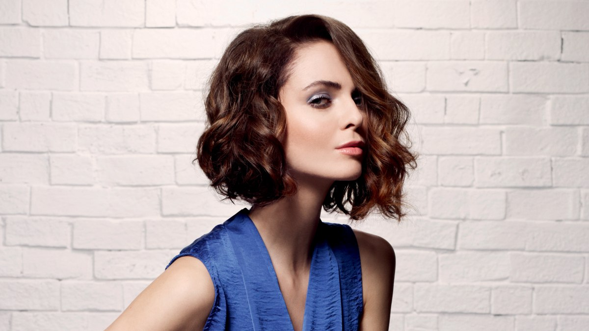 Contemporary Wavy Bob Hairstyle With A Longer Front Section