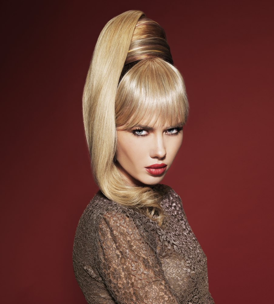 60s Look With The Hair Gathered Into A High Ponytail