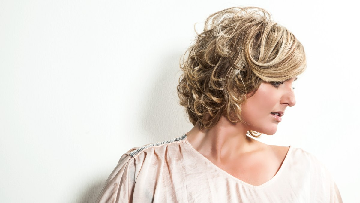 Easy To Wear Short Hairstyle With Dark Blonde Curls