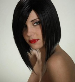 hairfashion with a long a line cut and white highlights for black hair