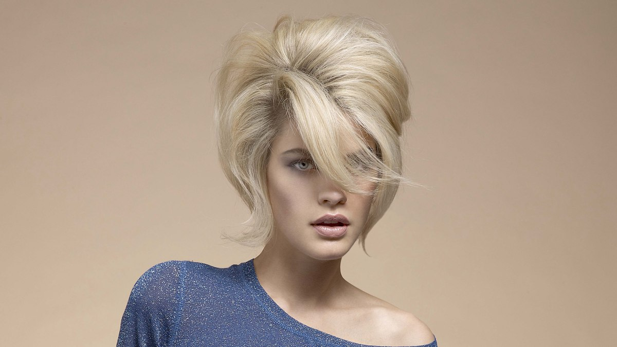 Top Heavy Retro Hairstyle With A Large Sweeping Fringe