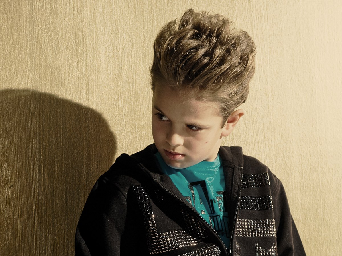 Boy With Longer Top Hair Which Is Lifted Up And Styled