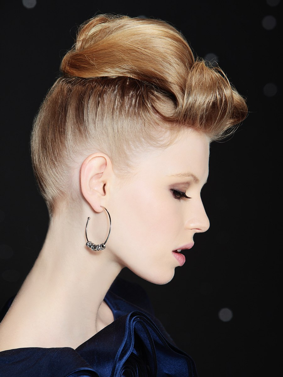 Updo With A Reverse Ponytail Styled Towards The Front