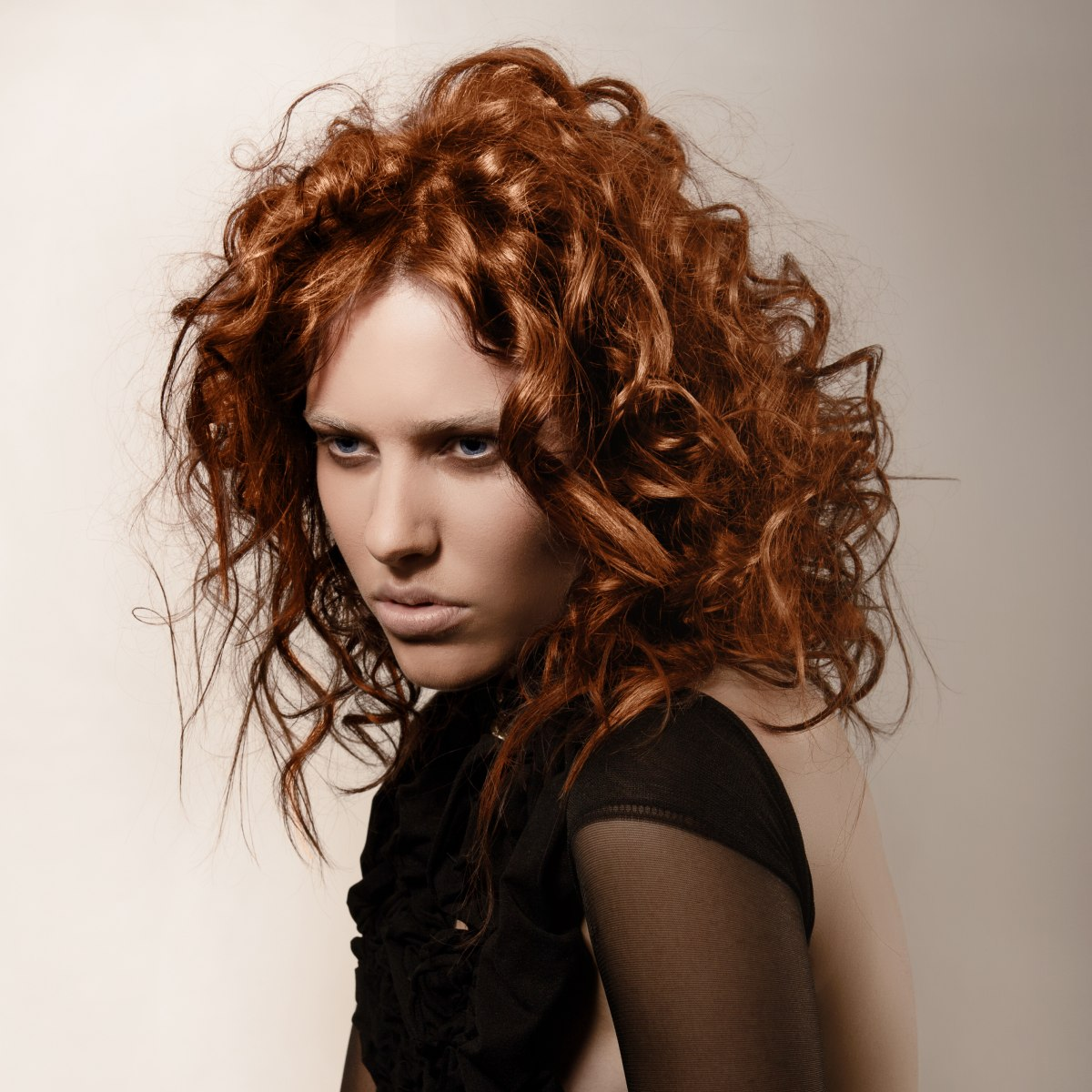 Hairstyle With Wild Copper Colored Curls And Messy Styling