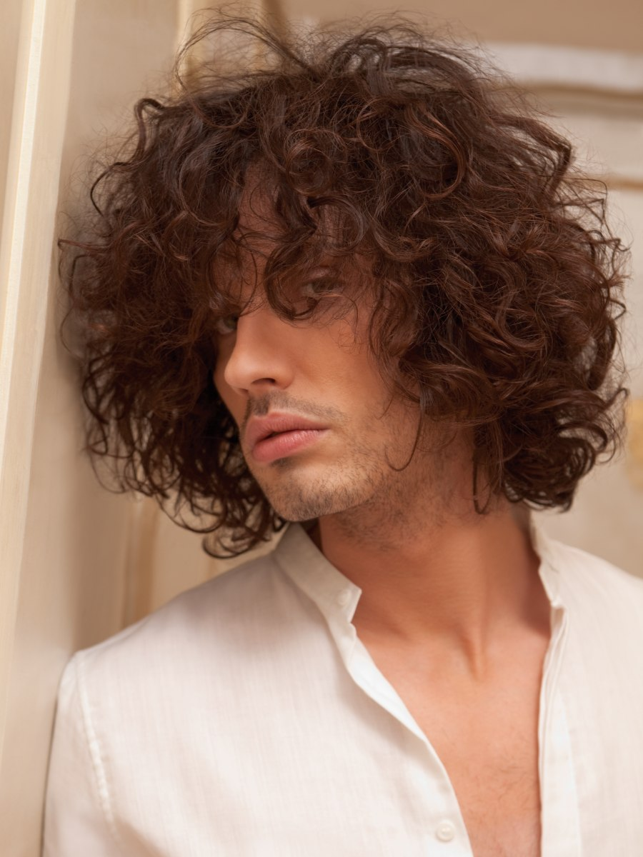 Mens Hairstyle With Large Curls And A Lot Of Motion