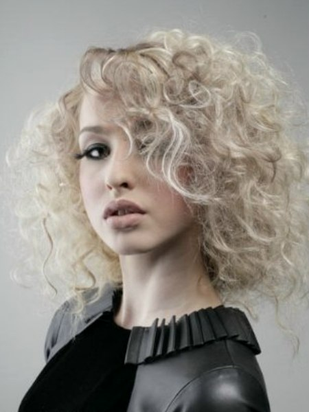 Youthful Hairstyle For A Striking High Fashion Femininity Look
