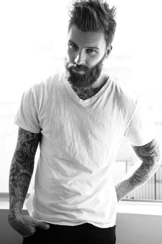 the ultimate example of a man with a beard tattoo hipster hairstyle