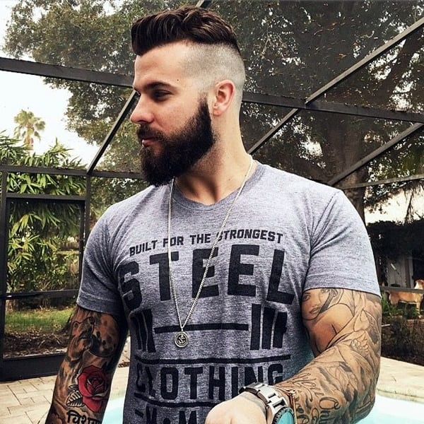 faded undercut hairstyle with full beard