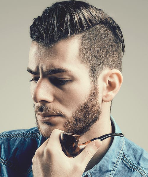 undercut hairstyle with short beard