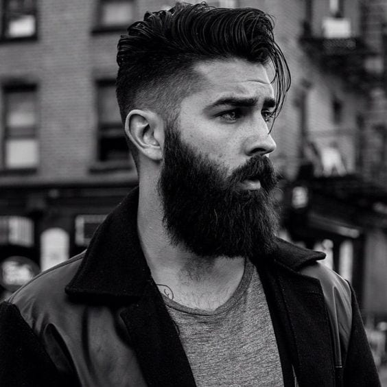 fade hairstyle on bearded man