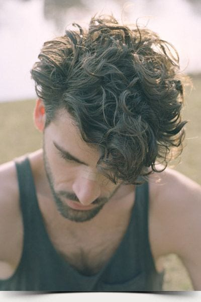 men with curly hair casual look