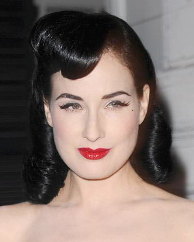 Vintage Hairstyles With Rolled Bangs
