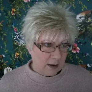 Patricia wearing Lizzy Wig in Creamy Blonde
