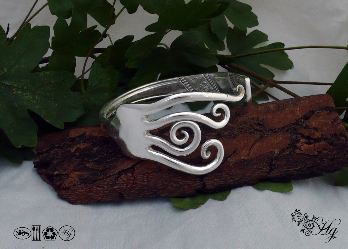 Handcrafted and recycled braking waves fork bangle