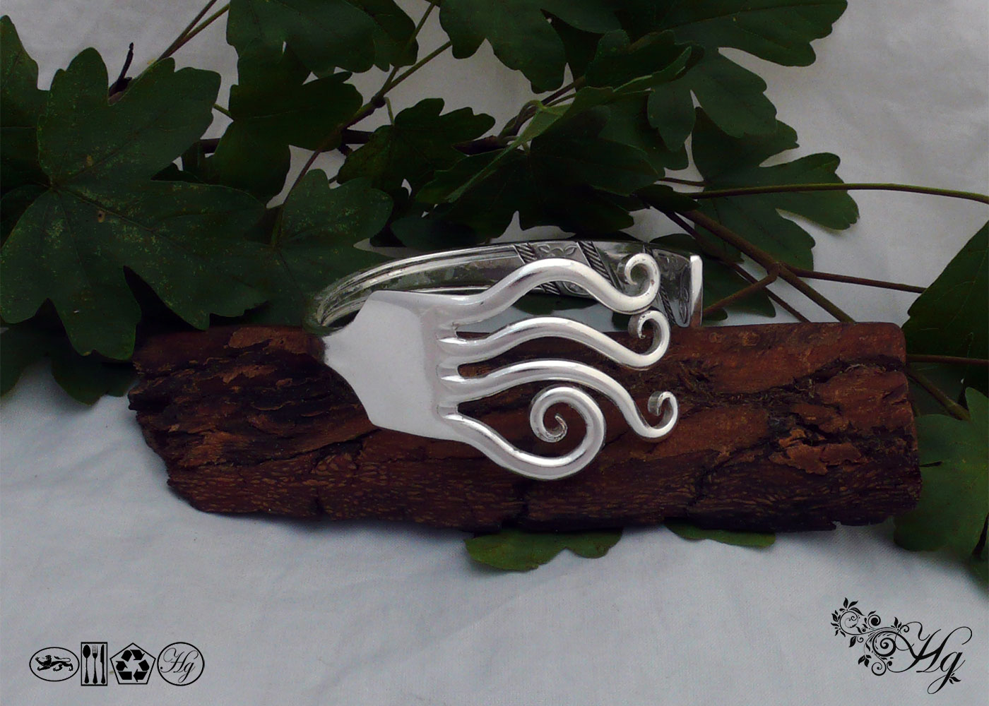 Handcrafted and recycled silver waves bangle