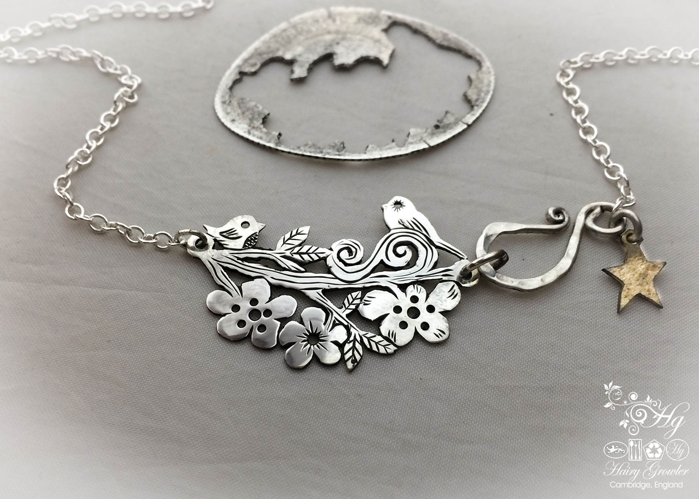 Handcrafted, upcycled, sterling silver, birdsong, tweet necklace being handmade