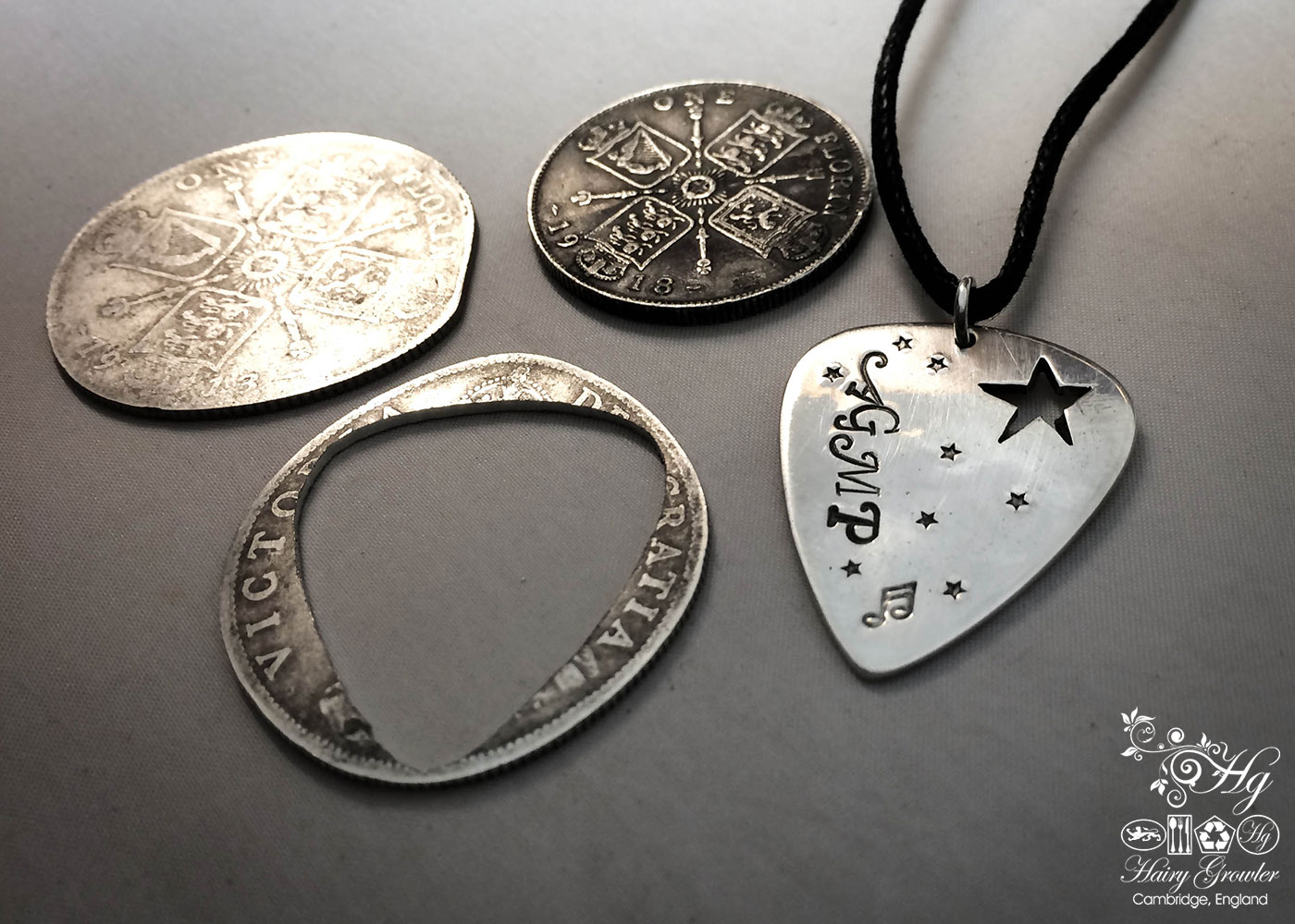 handcrafted and recycled silver coin plectrum necklace