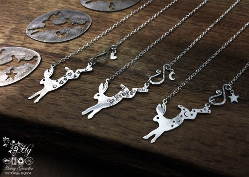 Handmade and upcycled sterling silver magical leaping hare necklace being cut out of the silver coin
