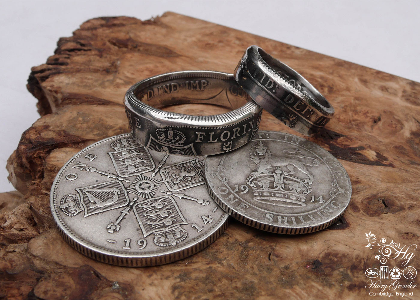 Handmade and recycled silver coin rings being sized in the workshop