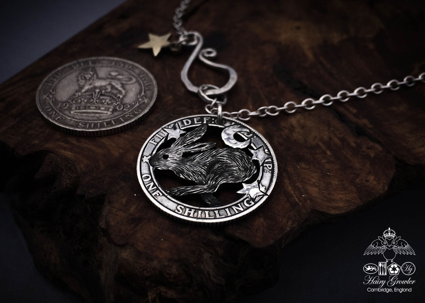 Handmade and recycled silver shilling The Silver Shilling collection. silver running wild hare necklace totally handcrafted and recycled from old sterling silver shilling coins. Designed and created by Hairy Growler Jewellery, Cambridge, UK. necklace