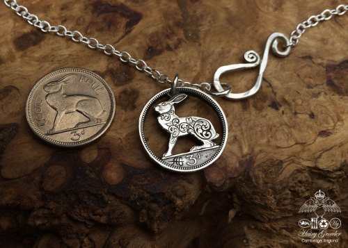 Hand-cut and carved Irish hare threepence coin pendant