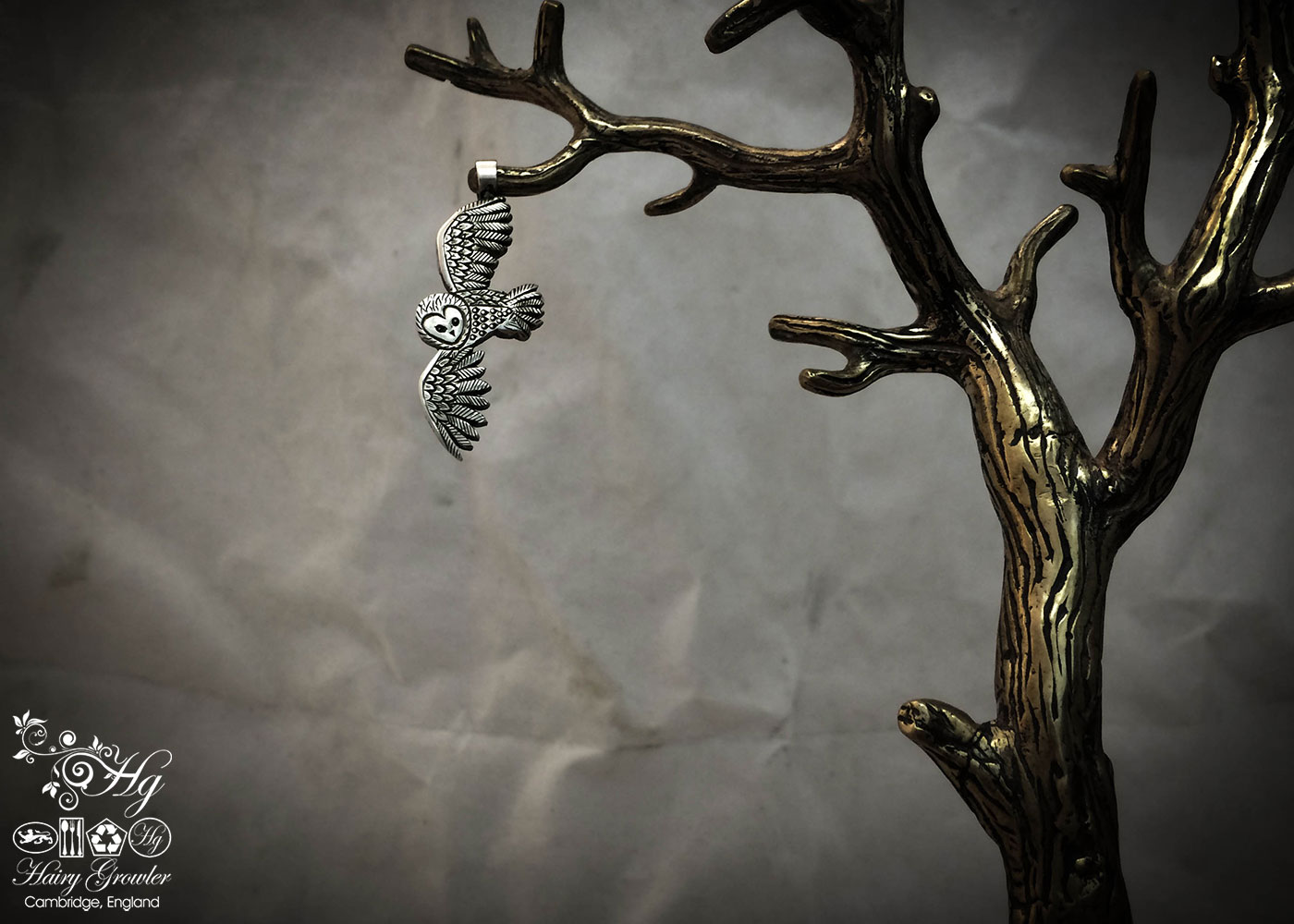 handmade and recycled silver coins flying playful owl charm for a tree sculpture, necklace or bracelet