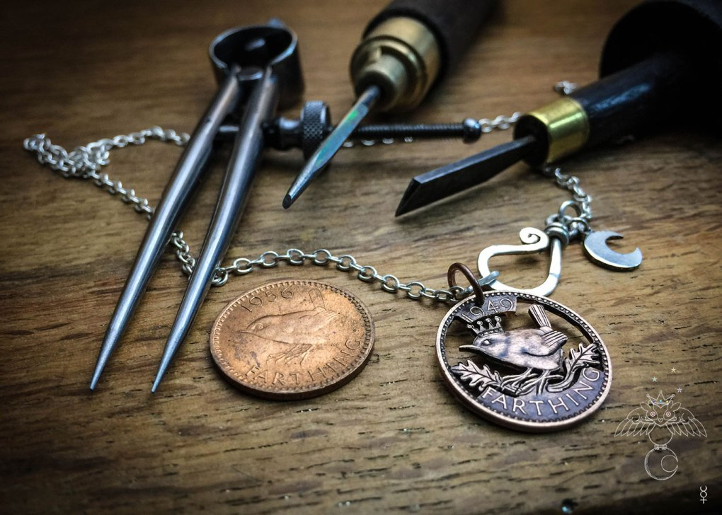 Jenny Wren king of the birds.  Hand cut coin jewellery made in Cambridge by Hairy Growler artisan independent jeweller.  Each piece is handmade and crafted from only recycled, ethical raw materials inline with the golden rule.