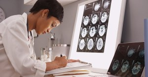 doctor reading paperwork - doctor-reading-paperwork