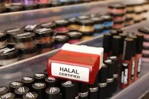A halal certified stamp lies on a make-up table