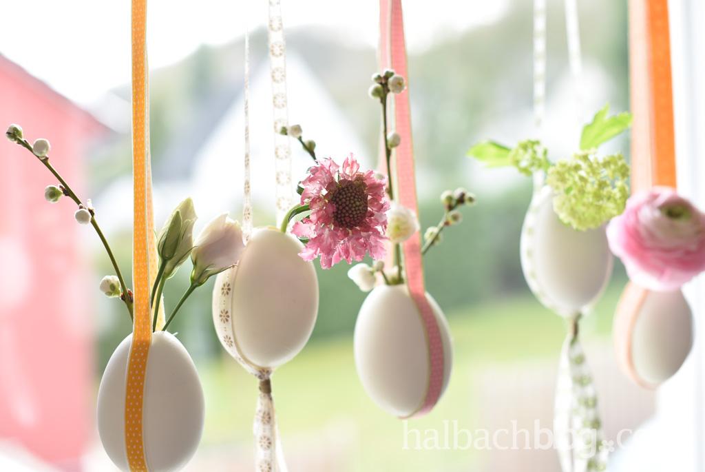 halbachblog-dekoidee-fuer-ostern-haengende-eier-mit-blumen-baender-pastellfarben