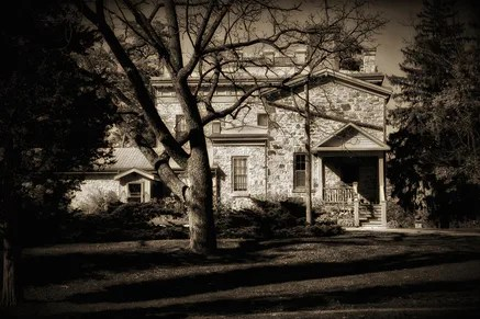 A sepia photo of an old home