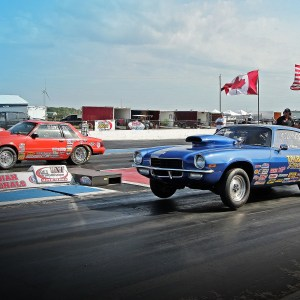 two cars at the drag strip