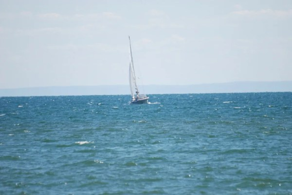 A sailboat in the distance on Lake Erie