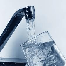 faucet filling glass