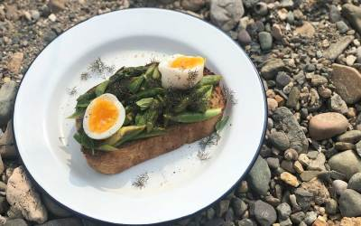 Asparagus on toast with soft boiled eggs + herbs