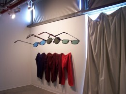 Group Sunglasses, suspended at eye level. Group Pants in the background.