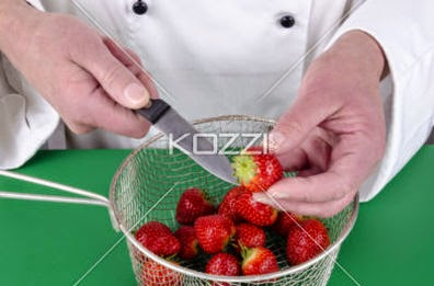 Female Chef Preparing Some Strawberries