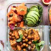 Meal Prep Moroccan Chickpea, Sweet Potato, and Cauliflower Bowls.