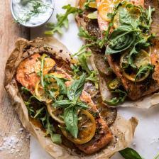 Parchment Baked Lemon Salmon and Potatoes with Dill Yogurt   halfbakedharvest.com #healthy #recipe #salmon #easyrecipe