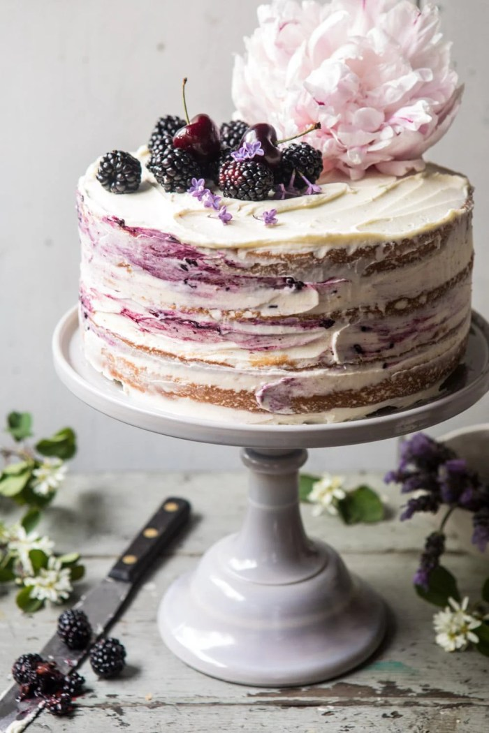 close up side angled photo of Blackberry Lavender Naked Cake with White Chocolate Buttercream