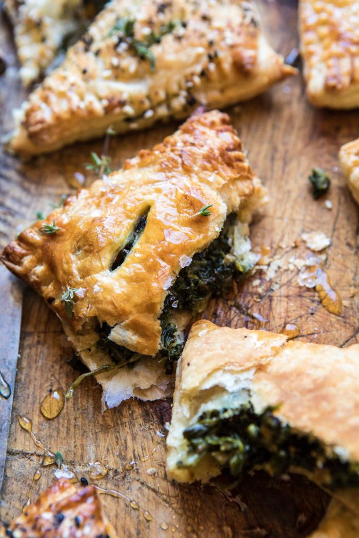 side angle photo of broken Caramelized Onion, Spinach, and Cheddar Flaky Pastry