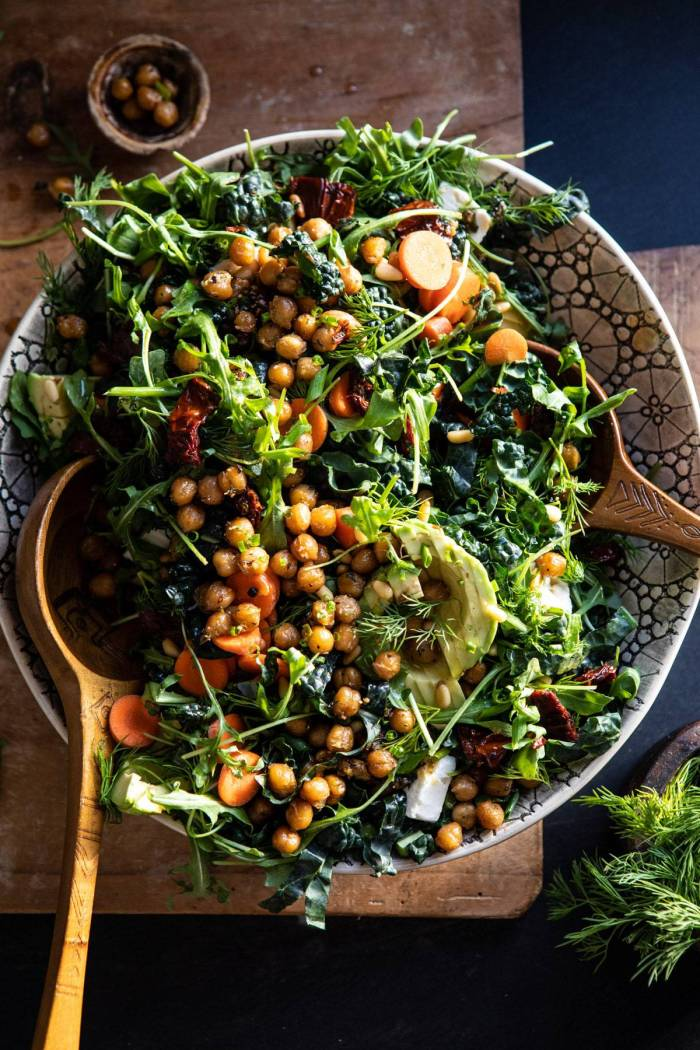 overhead photo of Super Green Sun-Dried Tomato Herb Salad with Crispy Chickpeas tossed in a bowl