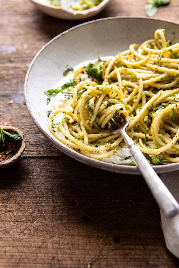 side angled photo of Broccoli Pesto Pasta with Whipped Ricotta and fork in bowl